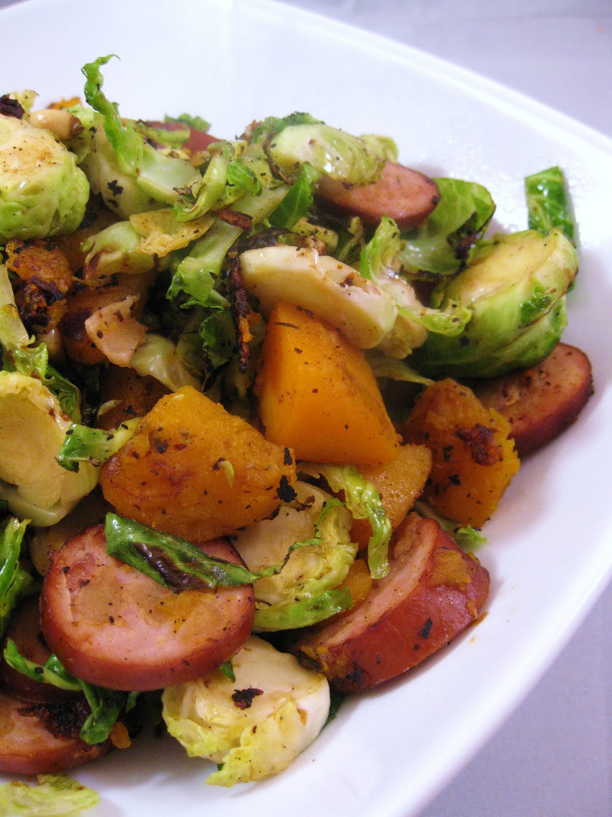 Shredded Brussels Sprouts With Winter Squash And Apple Chicken Sausage
